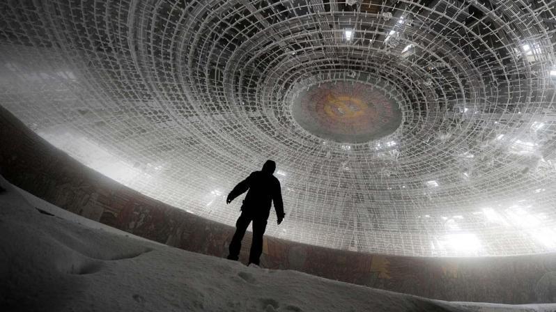man_walks_crumbling_skeleton_House_Bulgarian_Communist_Party_Mount_Buzludzha_Bulgaria_20121207